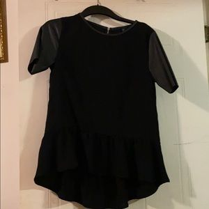 Black shirt with leather sleeve